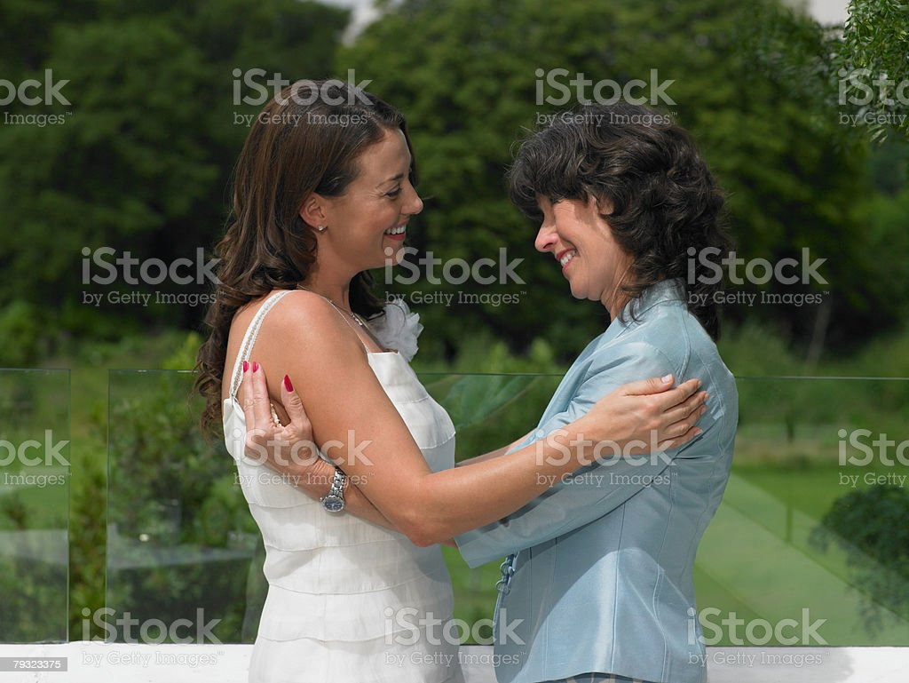A wedding guest hugging the bride 免版稅 stock photo