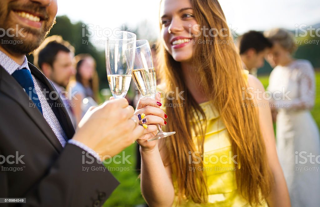 Wedding guests clinking glasses stock photo