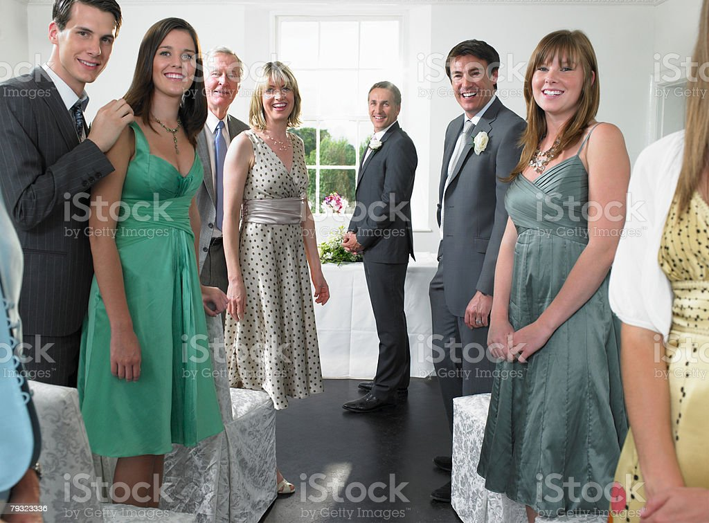 Wedding guests looking down aisle 免版稅 stock photo