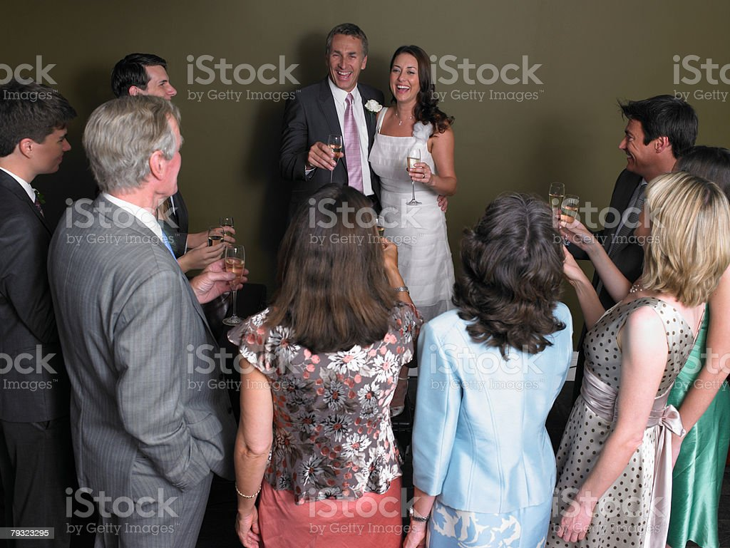 Wedding guests toasting the bride and groom royalty-free 스톡 사진