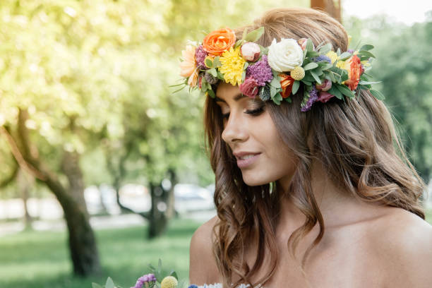 wedding hair style - bride with flower wreath, bridal event. - prom fashion stock photos and pictures