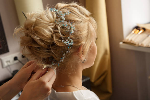 Wedding hairstyle and makeup. Makeup artist made makeup for beautiful bride at wedding day stock photo
