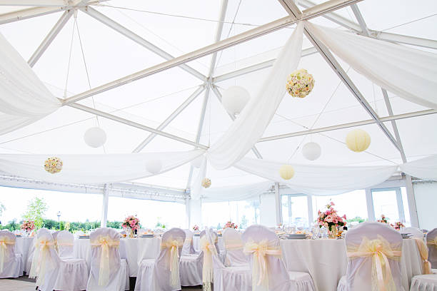 wedding hall an image of tables setting at a luxury wedding hall - wide angle view tent stock pictures, royalty-free photos & images