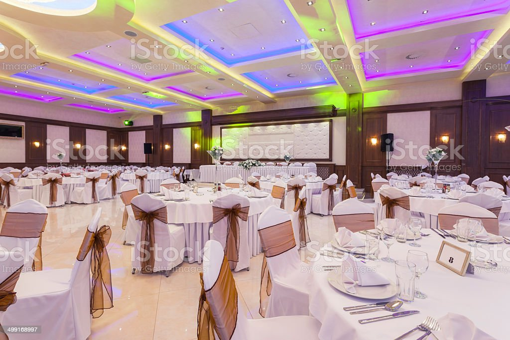 Wedding hall with colorful lights stock photo