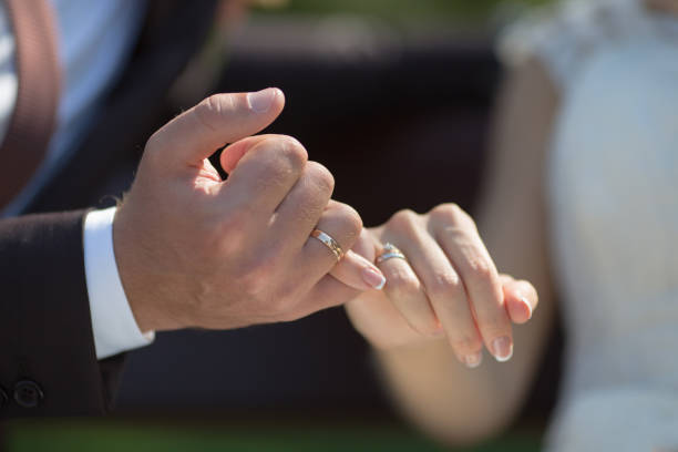 wedding hands - pinky promise stock photos and pictures