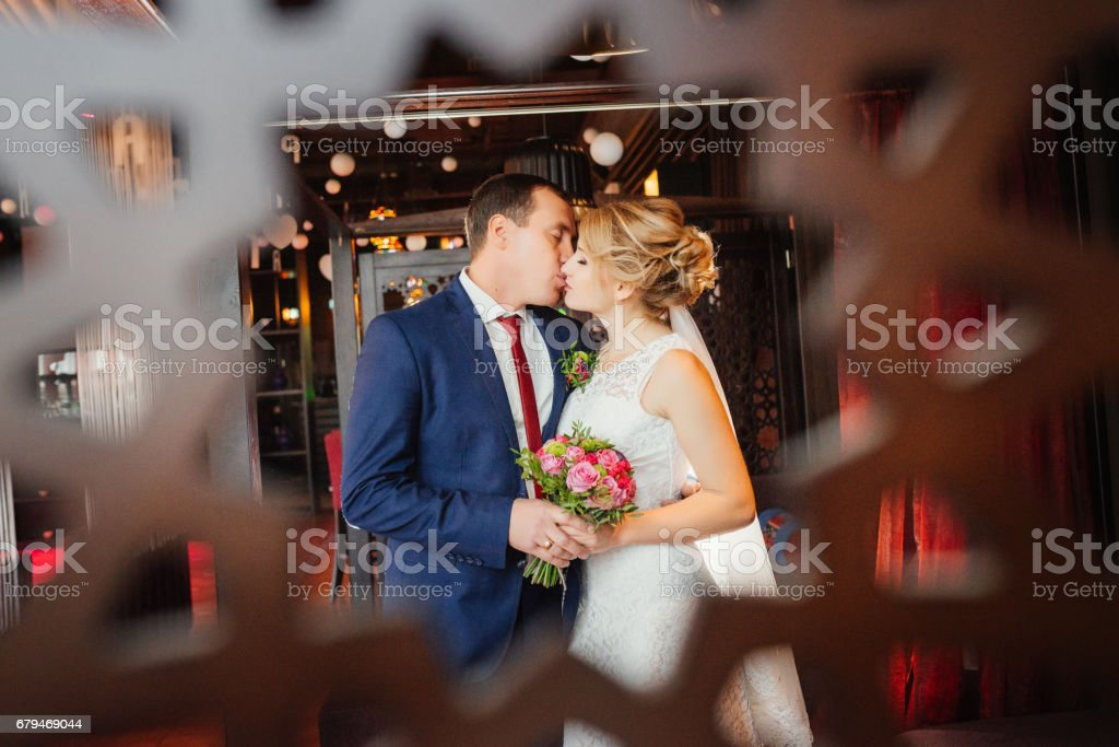 Wedding. Happy bride and elegant groom kissing. Wedding day. Love concept. royalty-free stock photo