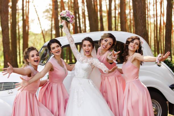 Wedding ideas. Bride and bridesmaids having fun on wedding day stock photo