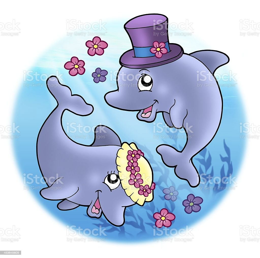 Wedding image with dolphins in sea stock photo