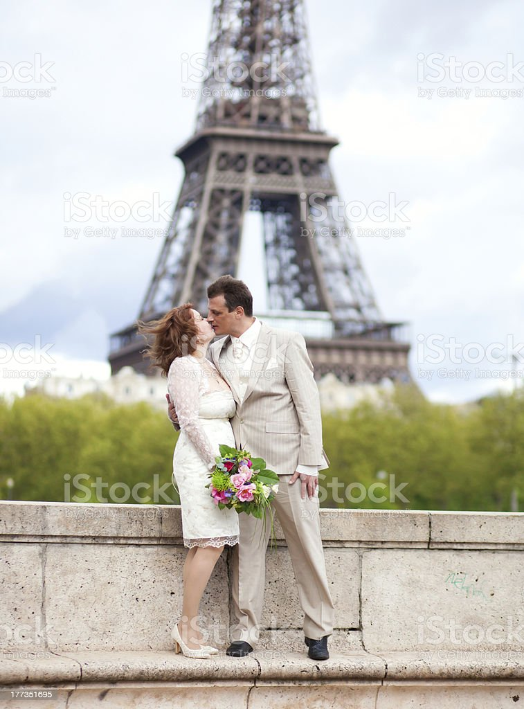 Wedding in Paris. Happy married couple near the Eiffel Tower royalty-free stock photo