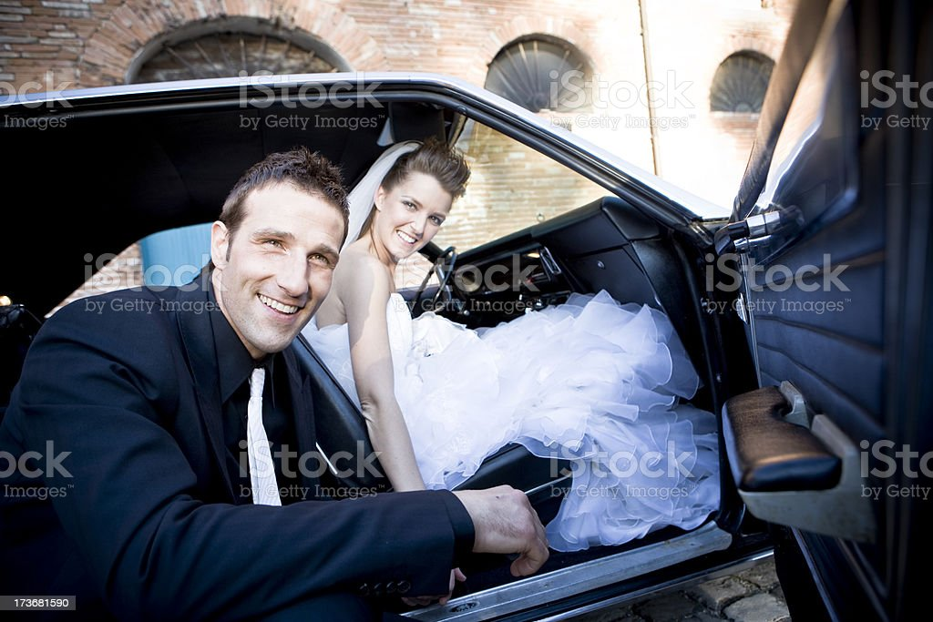 wedding into the car royalty-free stock photo