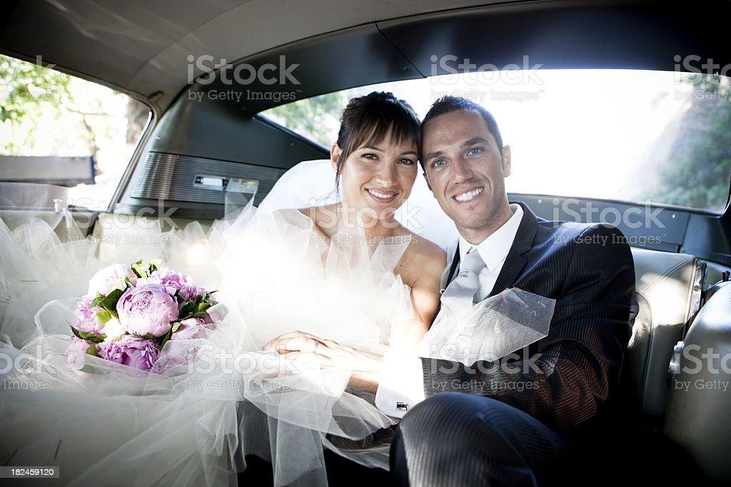 wedding into the car stock photo