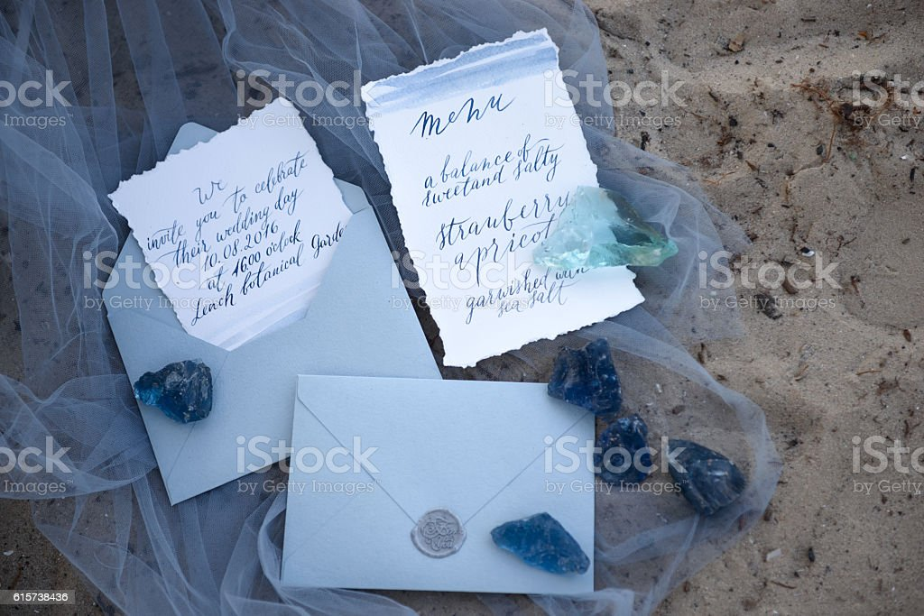 wedding invitation. accessories wedding on the sand stock photo