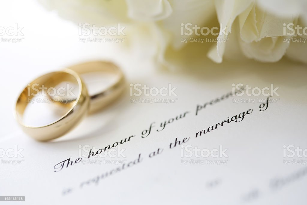 Wedding invitation and rings stock photo
