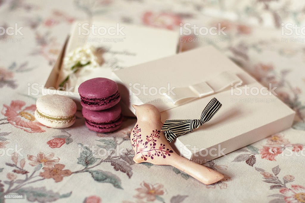 Wedding invitation, macaroons and bird decoration stock photo