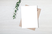 Wedding Invitation Mockup, Blank Party Invitation Card with a Sprig of Eucalyptus