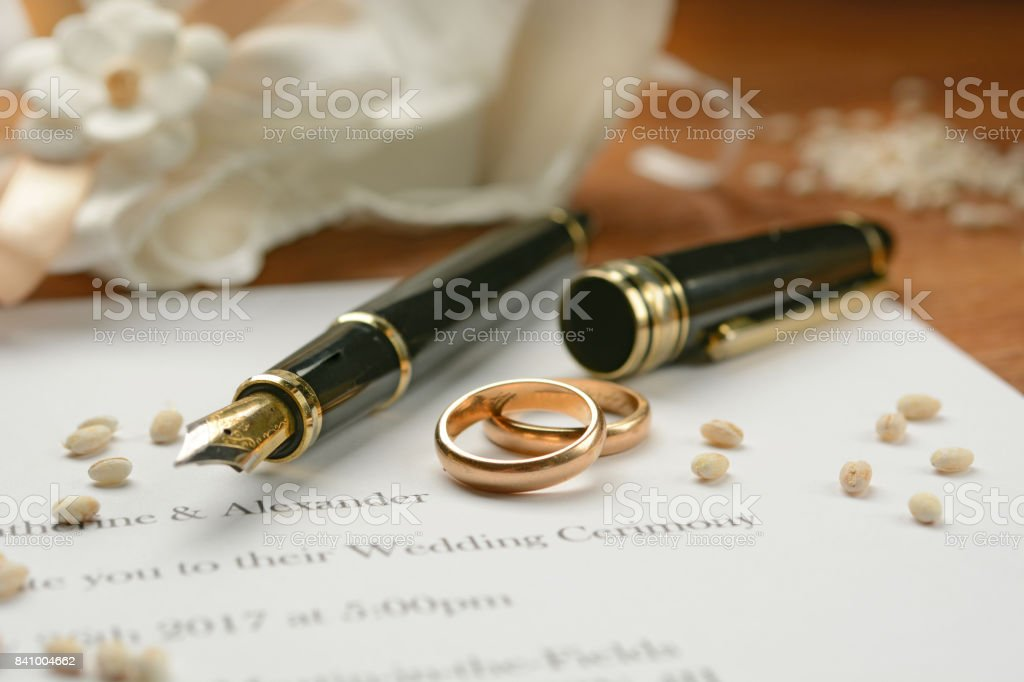 Wedding invitation with gold rings stock photo