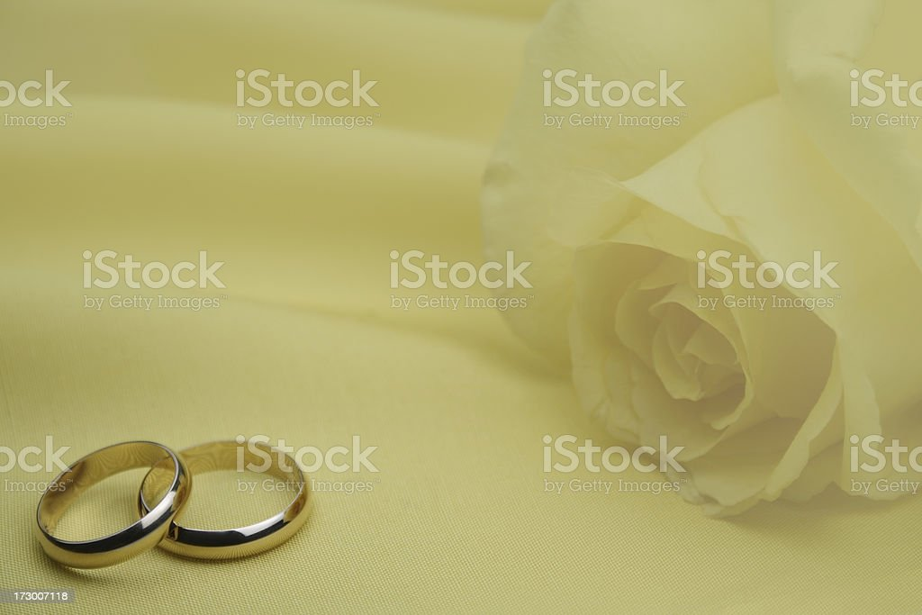 Wedding invitation with two golden rings. royalty-free stock photo