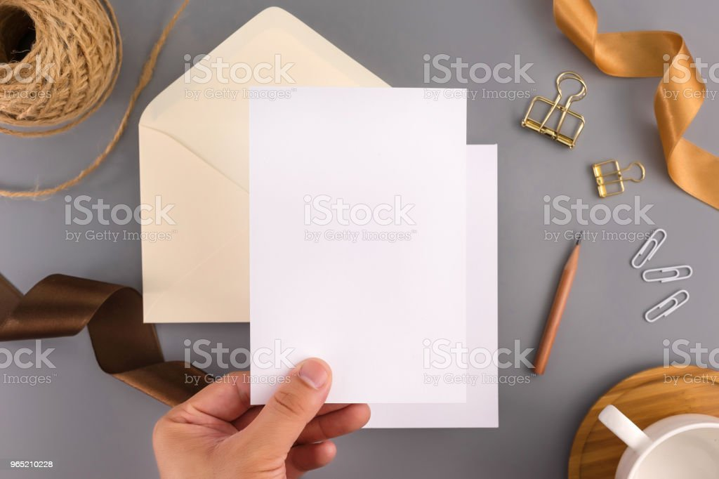 A wedding mock up concept. Wedding Invitation, envelopes, cards Papers on grey background with ribbon and decoration. Top view, flat lay, copy space zbiór zdjęć royalty-free