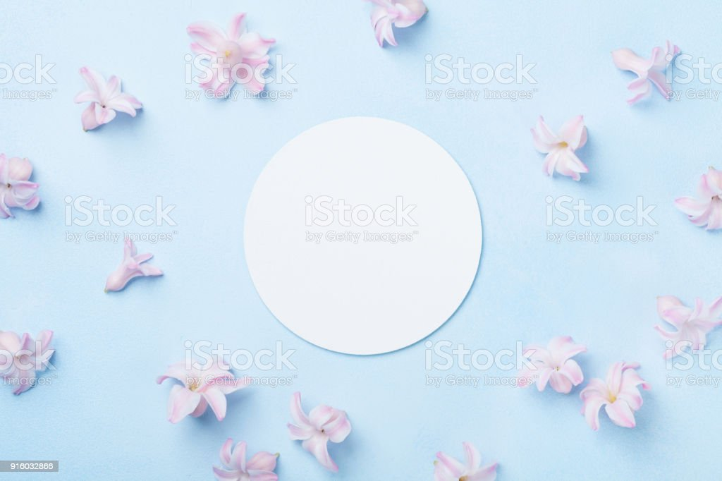 Wedding mockup with white paper list and pink flowers on blue table wedding mockup with white paper list and pink flowers on blue table from above beautiful mightylinksfo
