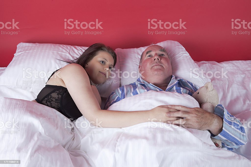Wedding Night Series:The Satisfied Couple And teddy stock photo
