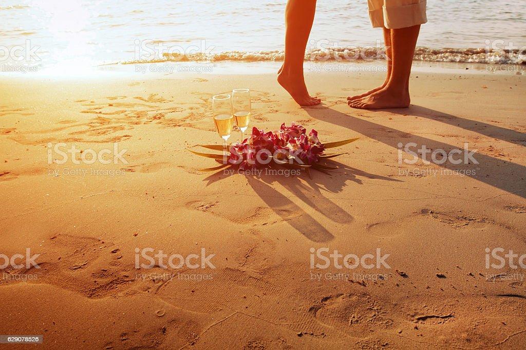 wedding on the beach, feet of romantic couple stock photo
