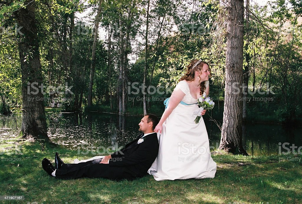 Wedding outdoors in the summer Bride dragging groom to alter stock photo
