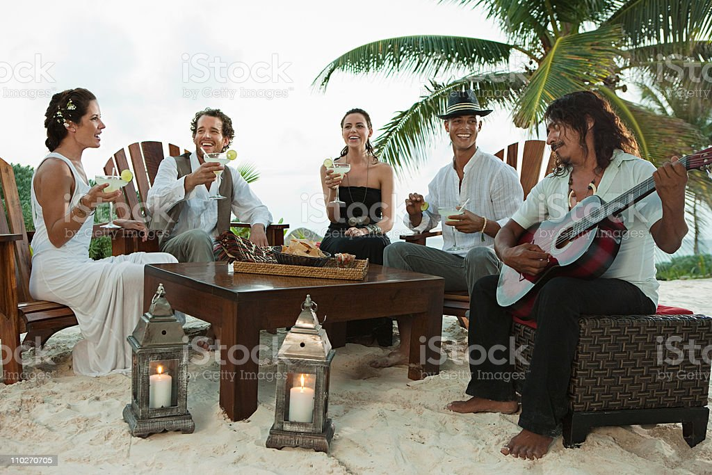 Wedding party and man playing guitar royalty-free stock photo