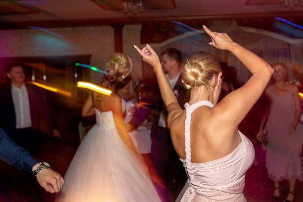 Wedding party. Guests and bridesmaids having fun and dancing on wedding banquet stock photo