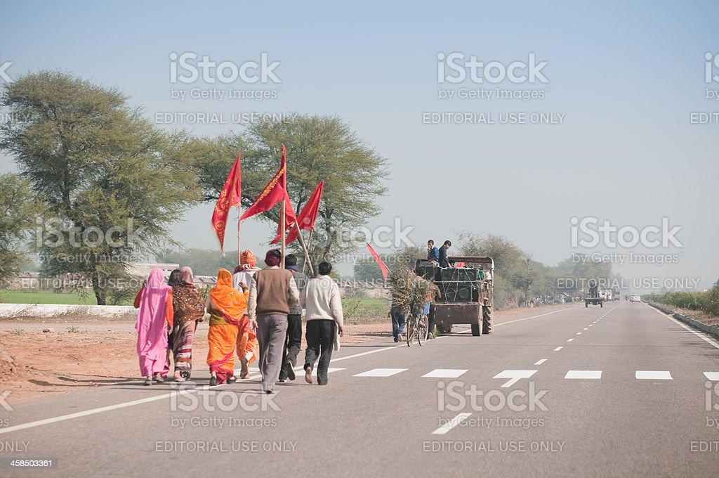 Wedding party on highway road in Rajasthan, India royalty-free stock photo