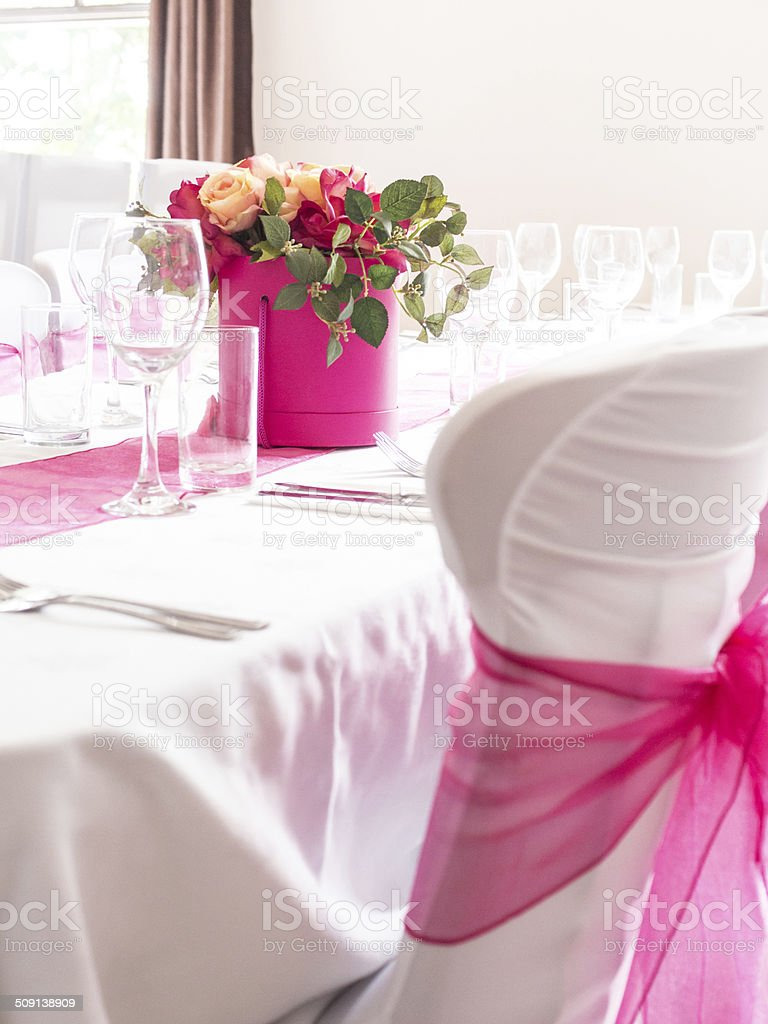 Wedding Party Table & Chair covers with pink Sash stock photo