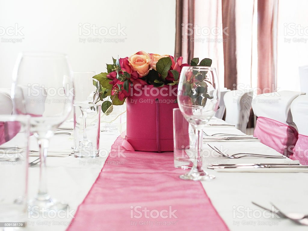 Wedding Party Table with Chairs and table runner stock photo