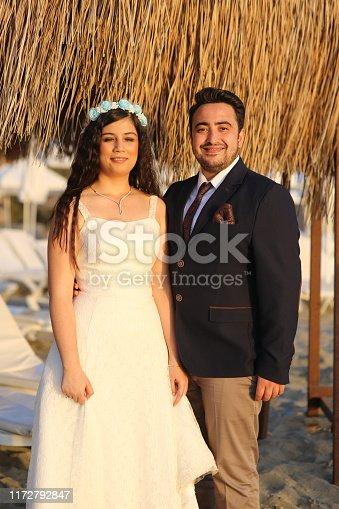 Wedding photo shoot on the beach in sunset