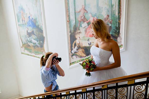 Wedding photographer is shooting portrait of the bride stock photo