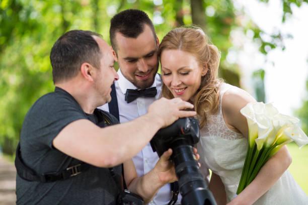 Wedding photographer showing the photos to the couple picture id1143082879?b=1&k=6&m=1143082879&s=612x612&w=0&h=yvm4jzu56 sms5kj2u73gcphvs8zju3mxus1wp3rkyq=