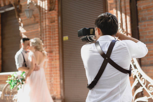 Wedding photographer takes pictures of bride and groom picture id1056678642?b=1&k=6&m=1056678642&s=612x612&w=0&h=vcrv5ljdk7nuve1xmk  4bh0yx9v9ydksguq9gqmx7a=