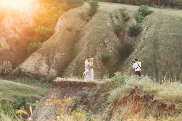 Wedding photographer takes pictures of bride and groom picture id1056679698?b=1&k=6&m=1056679698&s=612x612&w=0&h=t5fl85xvim axylw9ivuymkg9gprqxjefyoybvqnhsk=