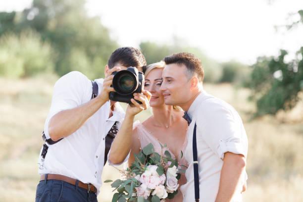 Wedding photographer takes pictures of bride and groom picture id1056679938?b=1&k=6&m=1056679938&s=612x612&w=0&h=xbs4c2bqvz 6phmozcdfp l3hptyekd dmuxxjizibm=