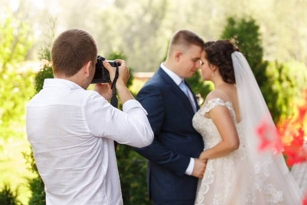 Wedding photographer takes pictures of the bride and groom stock photo