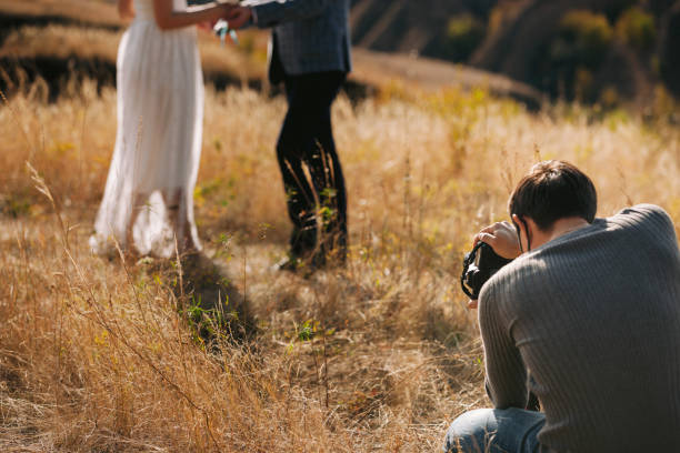 Wedding photographer takes pictures of the bride and groom picture id1182447535?b=1&k=6&m=1182447535&s=612x612&w=0&h=tbvo6i dq3pvqniqi l7pecx keluimzsrb2ft5kv4e=