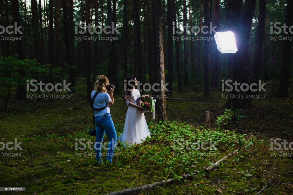 Wedding photographer using strobe and softbox to make close-up portraits stock photo
