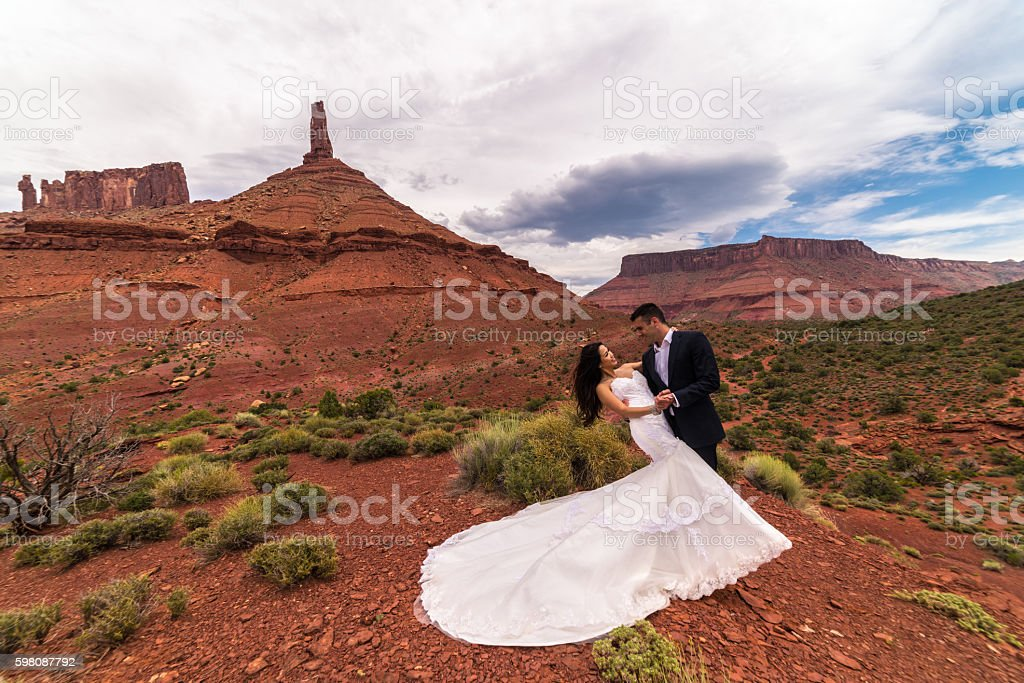 Wedding Photography.  Bride & groom in the Utah desert, Moab. stock photo