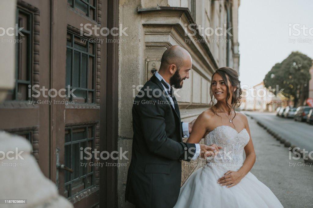 wedding photosesion young couple having fun at their wedding photosesion Adult Stock Photo