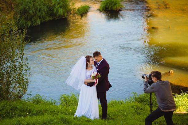 Wedding photoshoot near the river stock photo