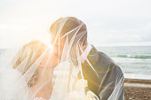 Just married: Wedding picture of young, beautiful couple standing on beach, Denmark