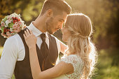 Beautiful just married couple at sunset. Wedding photography.