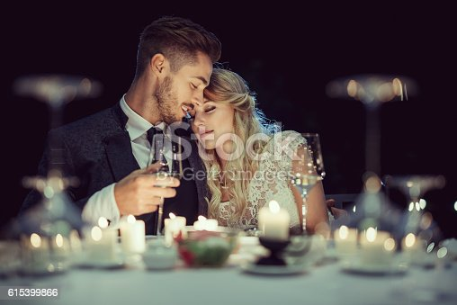 Just married beautiful couple has a romantic dinner