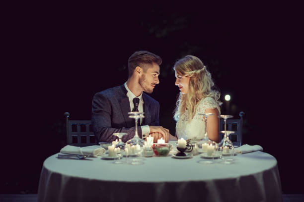 Wedding Beautiful just married pair having romantic dinner date night romance stock pictures, royalty-free photos & images
