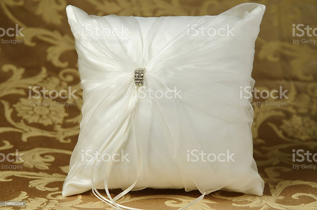 Wedding pillow with deco knot stock photo