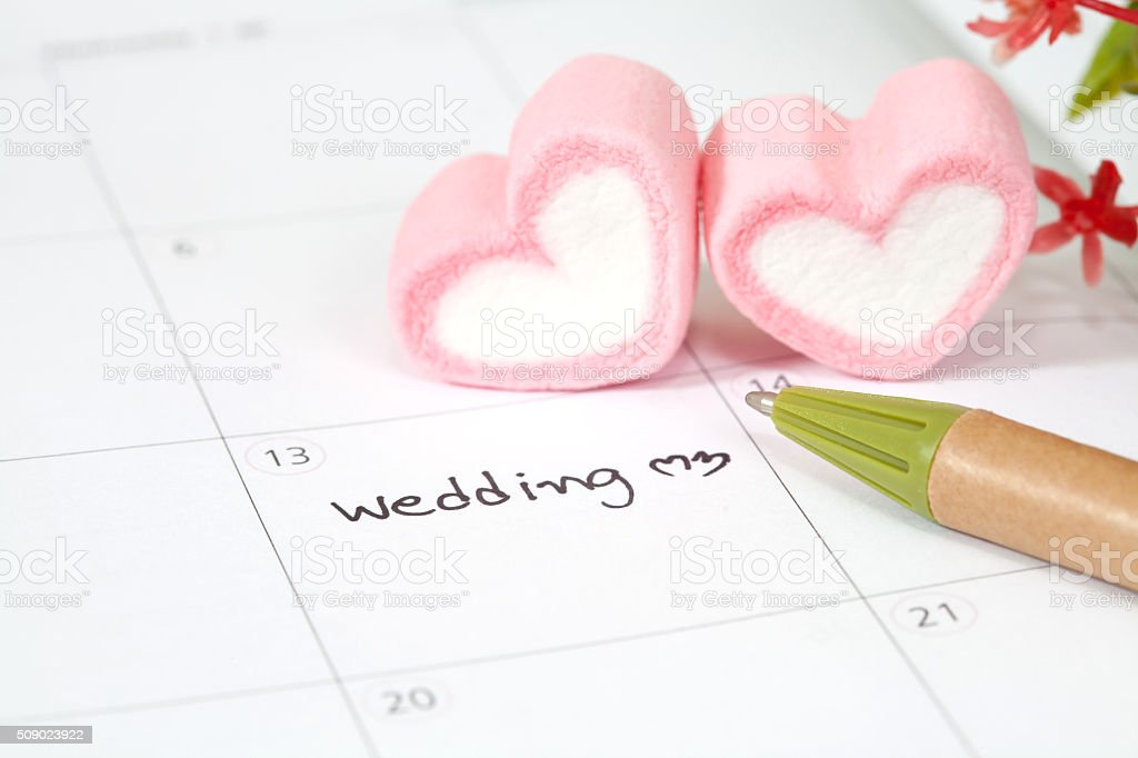 wedding plan on calendar and heart shape stock photo