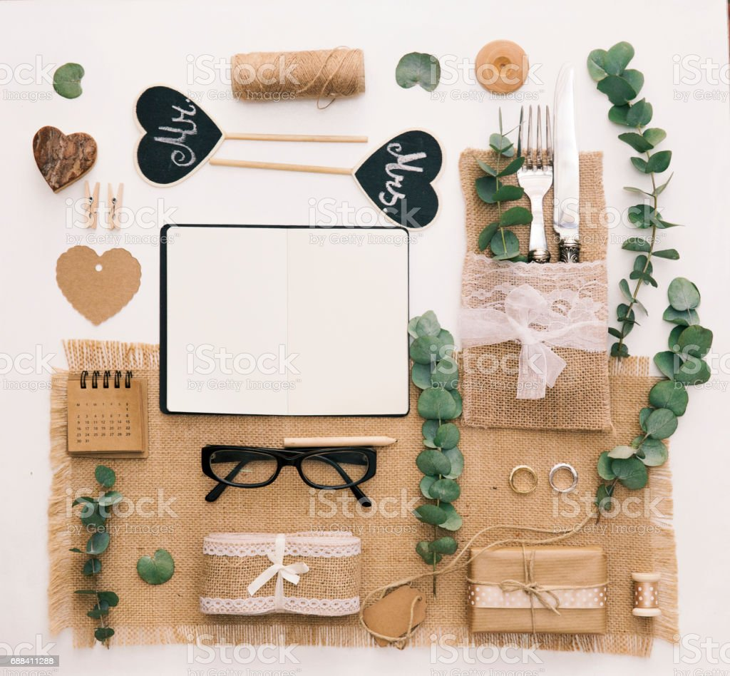 Wedding planner.  flat lay composition. Notebook with accessories and wedding decorations. Workspace, top view. stock photo
